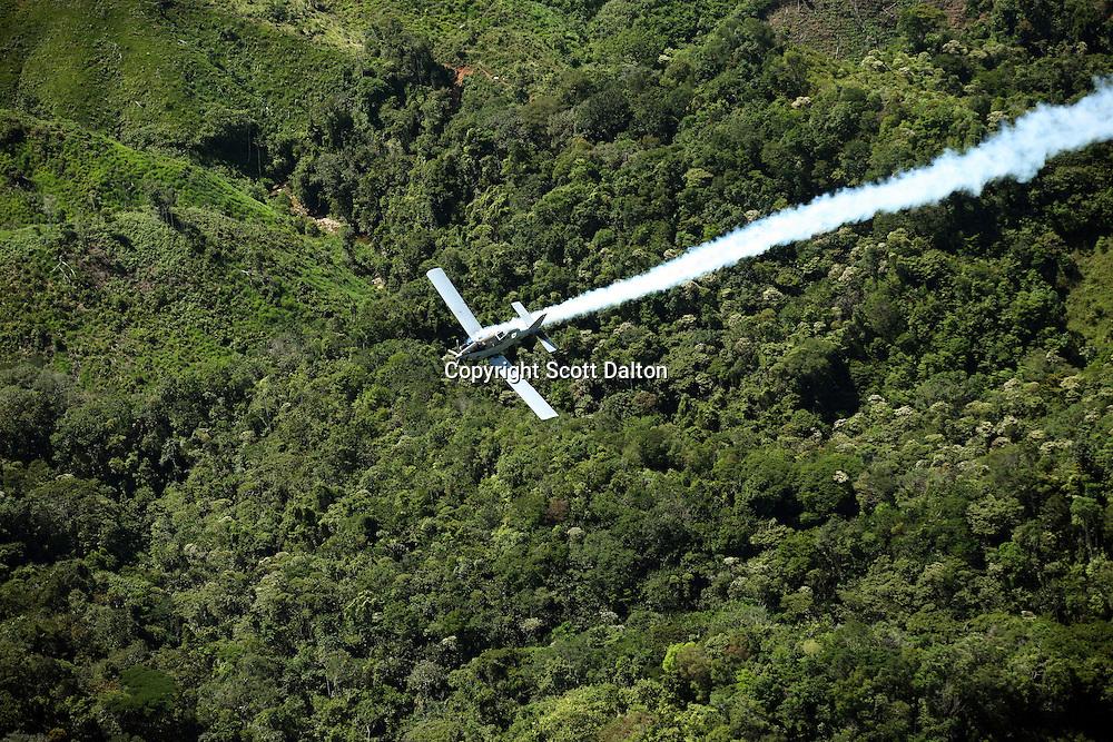 A plane fumigates coca fields outside of Mariquita, Colombia on Thursday, June 14, 2007. (Photo/Scott Dalton)