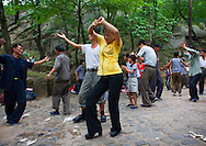 Electric power company workers dancing in a park. Kaesong Waterfall, North Korea.