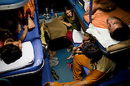 Kishore Raj Bal (bottom right), a dry fruits business owner and his extended family from Rajasthan and Bhopal return home after an 8 day holiday in Srinagar, Kashmir...Train passengers settle in to their berths in the air-conditioned coach on the Himsagar Express 6318 going from Jammu Tawi station to Kanyakumari on 7th July 2009.. .6318 / Himsagar Express, India's longest single train journey, spanning over 3720 kms, going from the mountains (Hima) to the seas (Sagar), from Jammu and Kashmir state in the Indian Himalayas to Kanyakumari, the southern-most tip of India..Photo by Suzanne Lee / for The National.