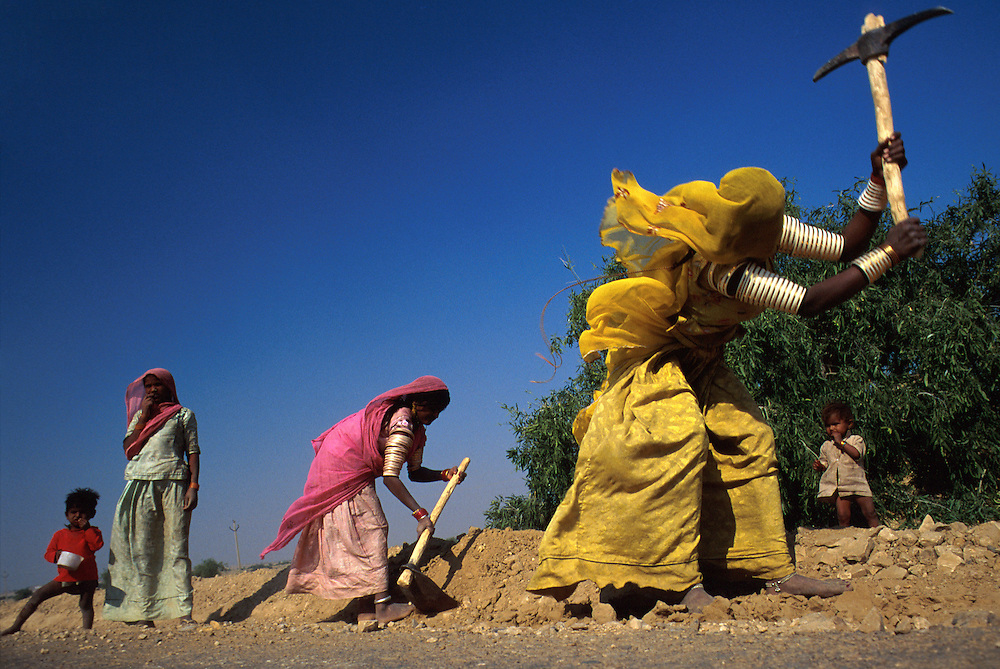 Tribal women of rajasthan build roads across the Thar Desert, near Jaisalmer, Rajasthan, India