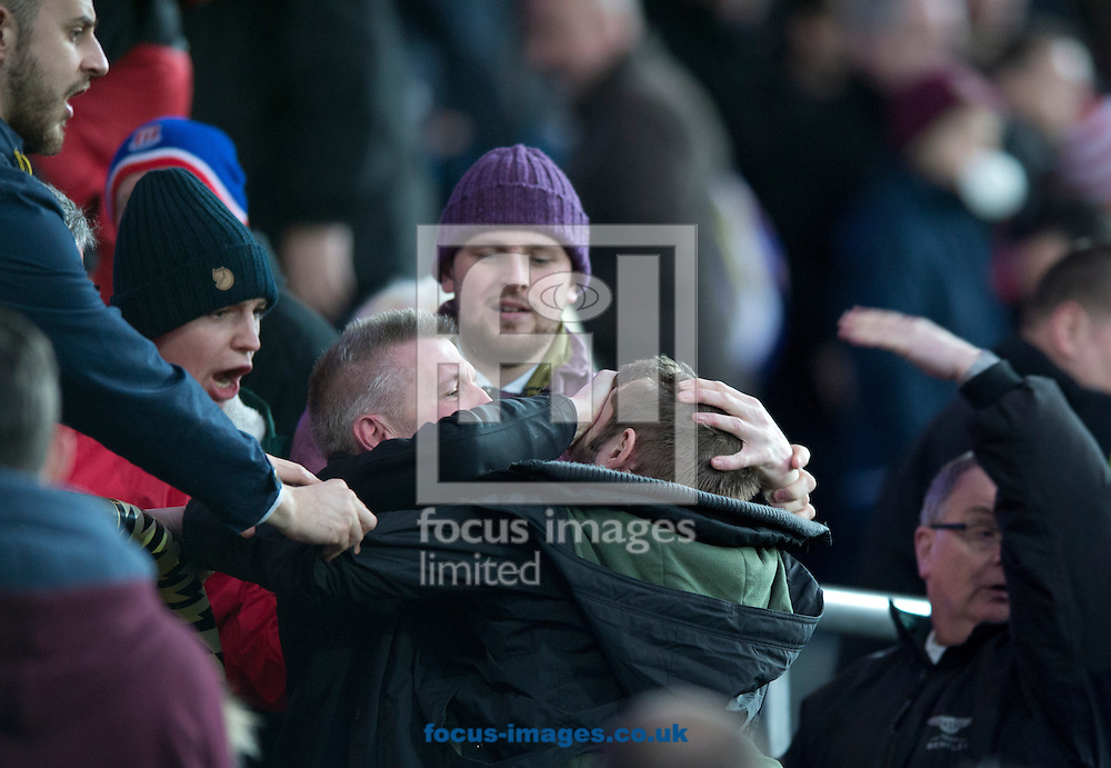 Stoke City fans fight amongst themselves following the FA Cup match at Ewood Park, Blackburn<br /> Picture by Russell Hart/Focus Images Ltd 07791 688 420<br /> 14/02/2015
