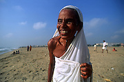 Woman happy after a dip in the sea, Chennai.