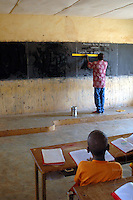 Burkina Faso, Bani, 2007. In Bani's only school, a mixed-age class prepares for the day's lesson in French.