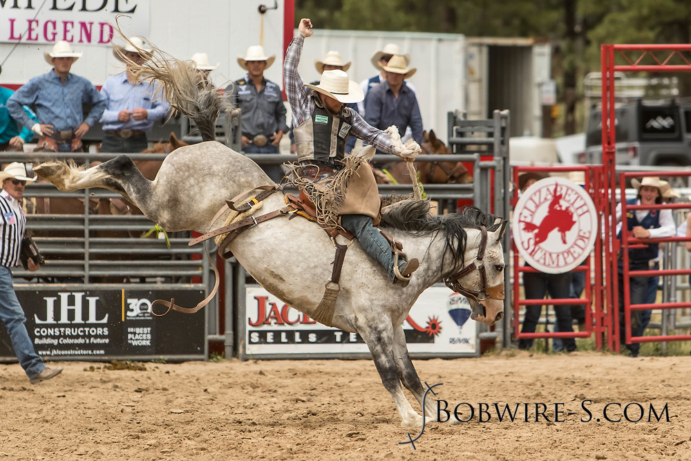 Saddle brond rider Tyrell Smith rides Summit Pro Rodeo's Western Expo during the third performance of the Elizabeth Stampede on Sunday, June 3, 2018.