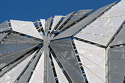 © Licensed to London News Pictures. 21/09/2016. LONDON, UK.  The Optic Cloak sculpture detail, seen near the Greenwich Peninsula.  The Optic Cloak, designed by artist, Conrad Shawcross is based on tetrahedra and is the exterior camouflage for a 49 meter tall chimney, that will house a new low-carbon energy centre and provide power to new homes in the area.  Photo credit: Vickie Flores/LNP
