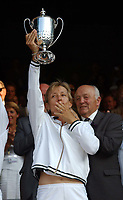 Martina Navratilova blows kisses to the Centre Court crowd after winning the Mixed Doubles title, her record equalling 20th Wimbledon Title. Wimbledon Tennis Championship, Day 13, 6/07/2003. Credit: Colorsport / Matthew Impey DIGITAL FILE ONLY