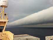 Amazing Roll cloud<br /> <br /> Its like a channel in the sky a roll cloud goes on for miles far out to sea off the Brazilian coast. This spectacular photo was captured last month and just released by NASA shows just how far these spectacular clouds can go. It was snapped by Captain Andreas van der Wurff stretching for hundreds of miles. Roll clouds are a type of arcus cloud, which is a category of low cloud formations. Their more common cousin is the shelf cloud, often seen on the leading edges of thunderstorms.  Roll clouds sometimes form along with storms, born out of the storm's downdraft. Sinking cold air causes warm, moist air on the planet's surface to climb to higher altitudes, where the moisture condenses into cloud form. Winds from the storm roll the cloud parallel to the horizon, creating an effect that looks much like a horizontal tornado. Unlike shelf clouds, rolls clouds are completely detached from the bulk of the storm. Roll clouds aren't dangerous in themselves, though, and many roll clouds form in relatively calm weather as a result of sea breezes. One of the most famous spots for these coastal roll clouds is off the coast of Queensland, Australia, where the so-called Morning Glory roll cloud forms regularly in fall months.The ship this shot was taken from was en route from Paranagua, Brazil, to Montevideo, Uruguay, on February 6<br /> ©Andreas van der Wurf/Exclusivepix
