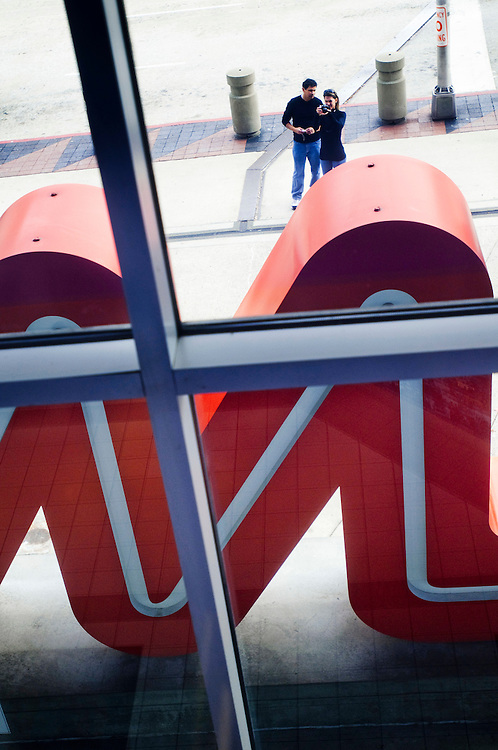 CNN Headquarters in Atlanta..A couple taking pictures of the CNN logo outside the entrance to the CNN building in Atlanta