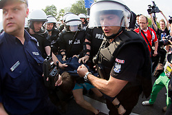 Police arrested Russian fan at march through Warsaw to mark their national day before UEFA EURO 2012 group A match between Poland and Russia on June 12, 2012 in Jerozolimskie street, Warsaw, Poland.  (Photo by Vid Ponikvar / Sportida.com)