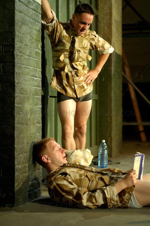 "National Theatre of Scotland play "" Blackwatch "" at the Edinburgh University Drill Hall.  The play is part of this years Edinburgh Festival Fringe.  Pictured bottom Brian Ferguson (Blonde Hair) as Cammy and top Emun Elliott (Dark hair) as Fraz."