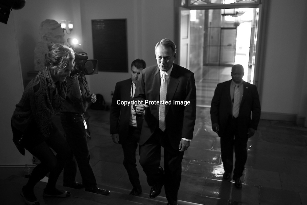 U.S. House Speaker John Boehner (R-OH) playfully pumps his fist in response to a reporter's question as he arrives at the U.S. Capitol in Washington, September 28, 2013. With conservative House Republicans promising not to back down on an emergency spending bill in a push to defund President Barack Obama's healthcare reform law, the U.S. government edged closer on Saturday to its first shutdown since 1996.