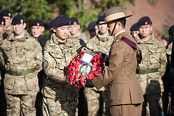 © London News Pictures. 11/11/12. Maidstone, Kent, Remembrance Day. A serving officer passes a wreath honouring their colleagues who have lost their lives in Afghanistan to the Gurkha Major of the Queen's Gurkha Engineers on Remembrance Day at the war memorial in Maidstone, Kent. Picture credit should read Manu Palomeque/LNP