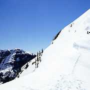 Andy Mahre dropping off of a cornice line in Glacier National Park.