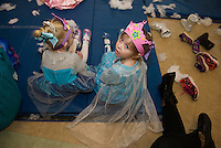 Alahni Mauzy and Sophia Benwell enjoy being princesses for the day during the Anna and Elsa Tea Party at Gilford Community Center Saturday morning.  (Karen Bobotas/for the Laconia Daily Sun)