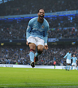 Joleon Lescott celebrates scoring during the Barclays Premier League match between Manchester City and Aston Villa at the City of Manchester Stadium on December 28, 2010 in Manchester, England.