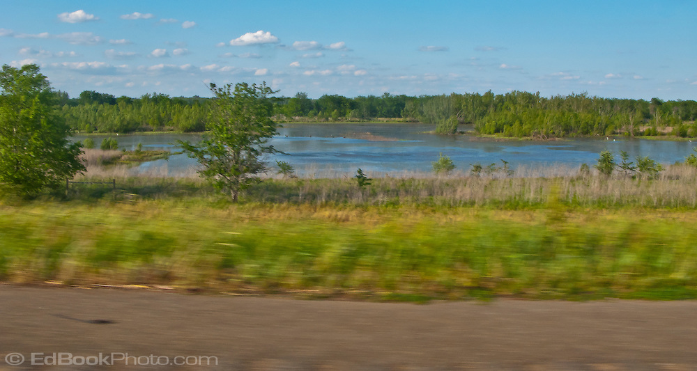 a lake along I 49 with motion blur in the foreground Louisiana, USA Panorama
