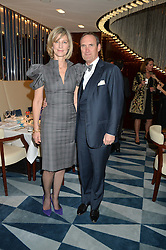 NICOLA FORMBY and AA GILL at a dinner hosted by AA Gill & Nicola Formby in support of the Borne charity held at Rivea at the Bulgari Hotel, Knightsbridge, London on 3rd February 2015.