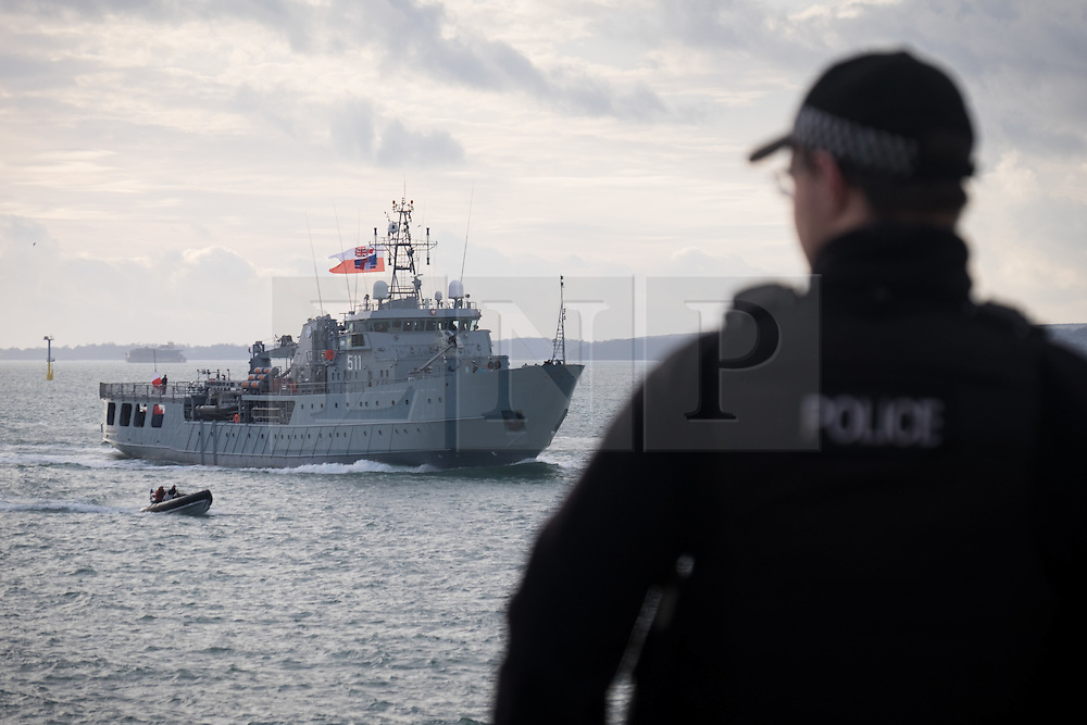 "© Licensed to London News Pictures. 09/01/2017. Portsmouth, UK.  A policeman on duty as the Polish Navy's youngest ship, ORP Kontradmiral Xawery Czernicki, (""Czernicki"") sail into Portsmouth Harbour under Police escort this morning, 9th January 2017. The multi-role support ship is visiting Portsmouth before deploying on a 6-month mission to join Standing NATO Maritime Group 2 (SNMG2) in the Mediterranean Sea. Photo credit: Rob Arnold/LNP"
