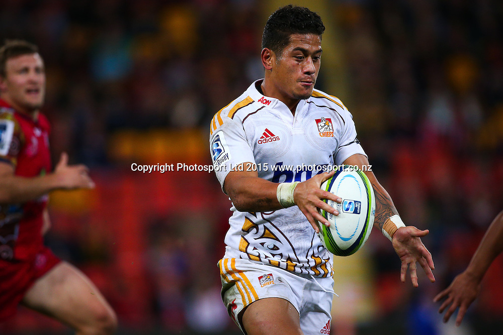 Augustine Pulu looks to kick ahead during the Super Rugby match between Chiefs v Reds, Suncorp Stadium,  Brisbane, Australia,  June 06, 2015.  Copyright Photo: Patrick Hamilton/ www.Photosport.co.nz