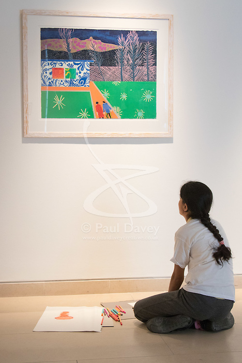 """Christies, St James, London, March 4th 2016. A girl from Charlton Manor Primary School admires  Tom Hammick's reduction woodcut """"Trailer"""" created in 2014, at the preview for the It's Our World charity auction at Christie's. Over 40 leading artists including David Hockney, Sir Antony Gormley, David Nash, Sir Peter Blake, Yinka Shonibare, Sir Quentin Blake, Emily Young and Maggi Hambling have committed artworks to the It's Our World Auction in support of The Big Draw and Jupiter Artland Foundation, to be sold at Christie's London on 10 March 2016.<br />  ///FOR LICENCING CONTACT: paul@pauldaveycreative.co.uk TEL:+44 (0) 7966 016 296 or +44 (0) 20 8969 6875. ©2015 Paul R Davey. All rights reserved."""
