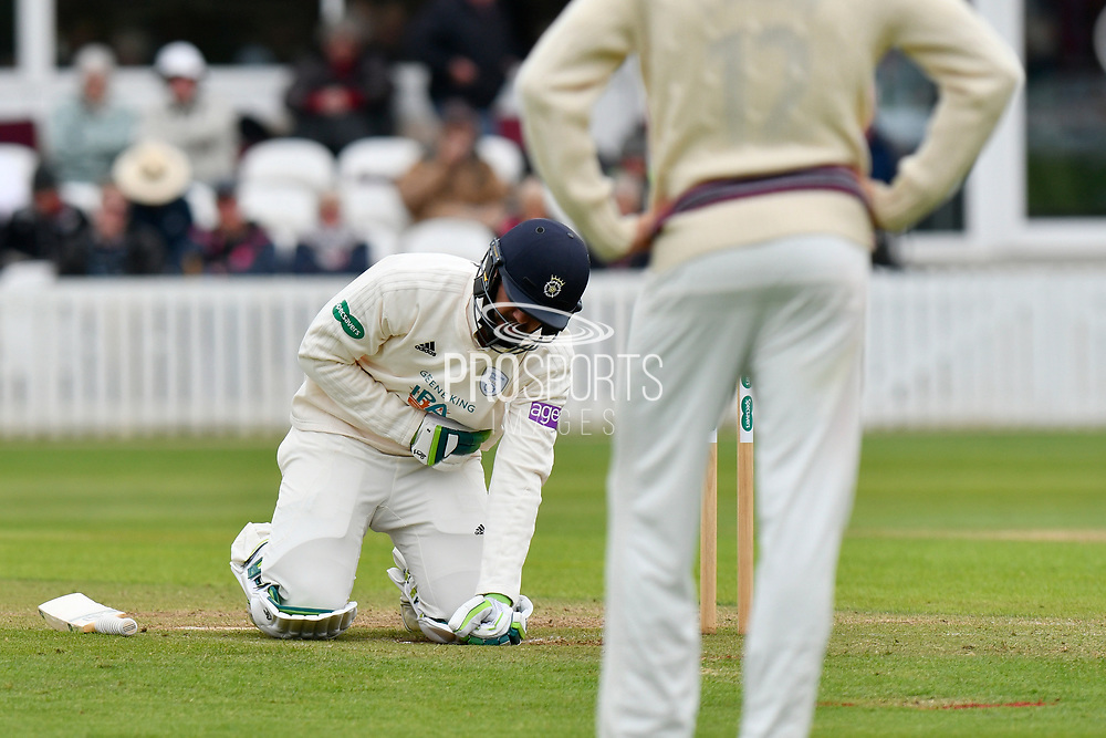 Rilee Rossouw of Hampshire holds his ribs after being hit by a short ball from Tim Groenewald of Somerset during the opening day of the Specsavers County Champ Div 1 match between Somerset County Cricket Club and Hampshire County Cricket Club at the Cooper Associates County Ground, Taunton, United Kingdom on 11 May 2018. Picture by Graham Hunt.