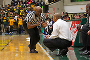 MEAC referee Jackie Sanders explains a call to Norfolk State Spartans head coach Anthony Evans during the Norfolk State - Hampton 2013 MEAC men's basketball game at the Echols Hall in Norfolk, Virginia.  January 26, 2013  NSU won 74-67.  (Photo by Mark W. Sutton)