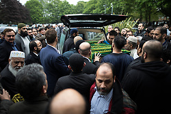 © Licensed to London News Pictures . 12/05/2017 . Manchester , UK . The coffin is carried away , after the service . Thousands of people fill a mosque , inside a marquee at the British Muslim Heritage Centre in Whalley Range , Manchester , for the funeral of Mawlana Habib-ur-Rahman , at the British Muslim Heritage Centre , Whalley Range , Manchester . Rahman , a former maths teacher and then imam at Manchester Central Mosque , died aged 90 following heart problems . As a well-known leader of Manchester's Muslim community he promoted interfaith dialogue and met the Pope during a Papal visit to Manchester in 1982 . Due to the number attending , crowds attending the funeral had to be diverted to rooms in nearby buildings to listen to the service via loudspeaker . Photo credit : Joel Goodman/LNP