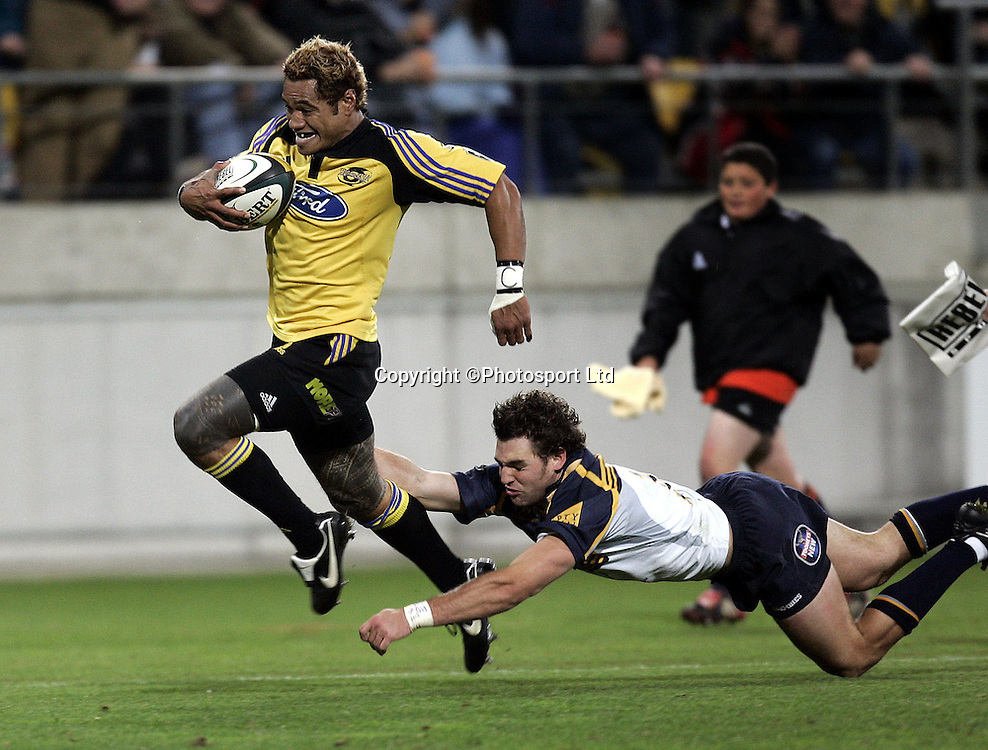 The Hurricanes  Lome Fa'atau scores a try against the Brumbies in their Super 12 rugby union match at Westpac Stadium, Wellington, New Zealand on Saturday 30 April, 2005.  Photo: Anthony Phelps/PHOTOSPORT