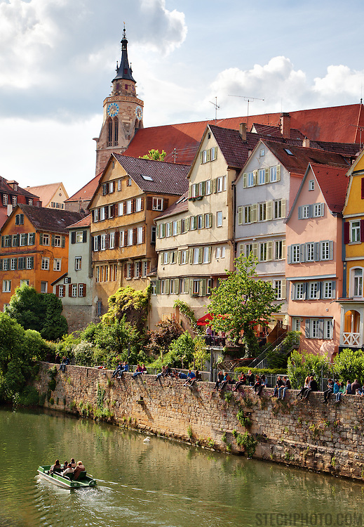 Students and tourists enjoying the weather and picturesque architecture of T&uuml;bingen, Germany. <br /> <br /> T&uuml;bingen is best described as a mixture of old and distinguished academic flair, including liberal and green politics on the one hand and traditional German-style student fraternities on the other, with rural-agricultural environs and shaped by typical Lutheran-Pietist characteristics, such as austerity and a Protestant work ethic, and traditional Swabian elements, such as frugality, order and tidiness. The city is home to many picturesque buildings from previous centuries and lies on the river Neckar.<br /> <br /> According to a national survey, T&uuml;bingen has the highest quality of life of all cities in Germany.