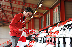 Volunteers help set out scarves on the seats - Photo mandatory by-line: Dougie Allward/JMP - Mobile: 07966 386802 - 25/01/2015 - SPORT - Football - Bristol - Ashton Gate - Bristol City v West Ham United - FA Cup Fourth Round