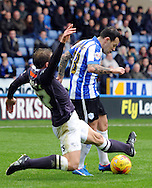Ross Wallace of Sheffield Wednesday is tackled by Stephen Warnock of Derby County during the Sky Bet Championship match at Hillsborough, Sheffield<br /> Picture by Graham Crowther/Focus Images Ltd +44 7763 140036<br /> 06/12/2015