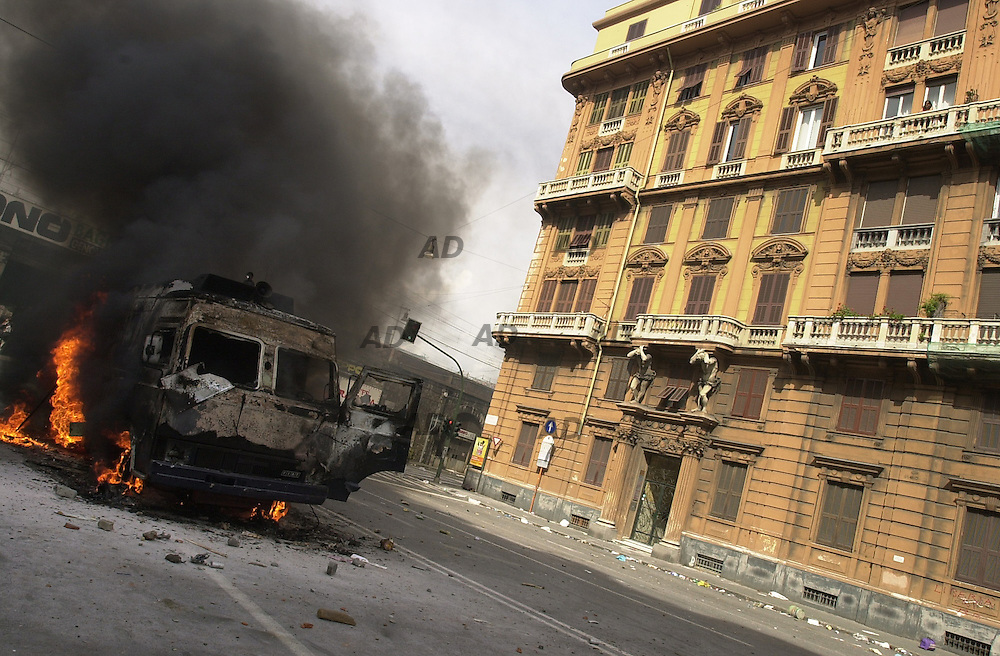 Carabinieri's jeep on fire.