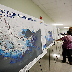 Residents review plans by LA Safe for flood risk projects for Lafourche Parish at a community meeting in Mathews, Louisiana, U.S., on Monday, December 18, 2017.   Louisiana is preparing recommendations through projects with LA Safe for emptying out coastal areas that are unprotected by levees and will be impacted by sea level rise in the coming years. Photographer: Derick E. Hingle/Bloomberg