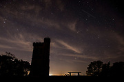 UNITED KINGDOM, Surrey Hills: 22 April 2020 <br /> A 'shooting star' can be seen by Leith Hill Tower in the early hours of this morning during the peak of the Lyrid meteor shower. This annual event occurs when Earth crashes through the dusty trail of C/1861 G1 Thatcher (commonly known as Comet Thatcher), lighting up the sky as particles enter the Earth's atmosphere.<br /> Rick Findler / Story Picture Agency