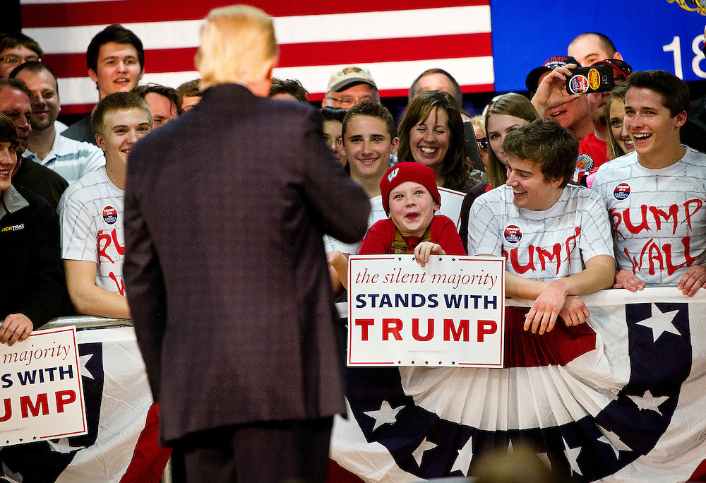 A young Donald Trump supporter reacts to being talked about by the Republican U.S. presidential candidate at a campaign town hall event in Wausau, Wisconsin April 2, 2016.   REUTERS/Ben Brewer