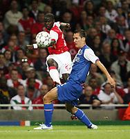 Photo: Chris Ratcliffe.<br /> Arsenal v FC Porto. UEFA Champions League, Group G. 26/09/2006.<br /> Emmanuel Eboue of Arsenal clashes with Marek Cech of Porto.