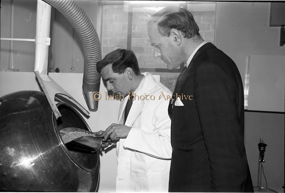 04/03/1964<br /> 03/04/1964<br /> 04 March 1964<br /> Smith Kline and French Laboratories personnel at Smith Kline and French Laboratories Ltd, Ashgrove, Dun Laoghaire Co. Dublin. Picture shows Mr. Tony Baker and Mr. Frank Sutton, Goodbody Ltd., examining somme of the products.