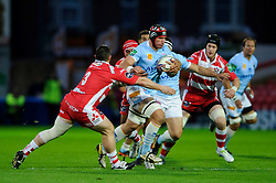 Perpignan Flanker (#7) Alasdair Strokosch is challenged by Gloucester Prop (#3) Shaun Knight and Number 8 (#8) Sione Kalamafoni during the first half of the match - Photo mandatory by-line: Rogan Thomson/JMP - Tel: 07966 386802 - 12/10/2013 - SPORT - RUGBY UNION - Kingsholm Stadium, Gloucester - Gloucester Rugby v USA Perpignan - Heineken Cup Round 1.