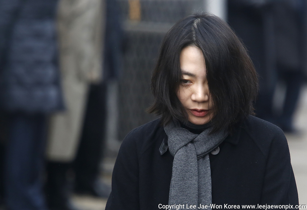 The eldest daughter of Korean airlines (KAL) Chairman Cho Yang-ho and former vice president of KAL, Cho Hyun-ah appears at Aviation and Railway Accident Investigation Board of Transportation Ministry in Seoul, December 12, 2014. The Accident Investigation Board summoned Cho on Friday to question for ordering a crew member to leave a plane over an alleged breach of snack-serving protocol at John F. Kennedy airport in New York City on December 5, 2014, local media reported. Photo by Lee Jae-Won (SOUTH KOREA) www.leejaewonpix.com/