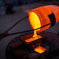 At the SOTRAMI laboratory and foundry, molten gold is poured into an ingot.