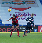 8th May 2018, Global Energy Stadium, Dingwall, Scotland; Scottish Premiership football, Ross County versus Dundee; Darren O'Dea of Dundee heads clear from Billy McKay of Ross County