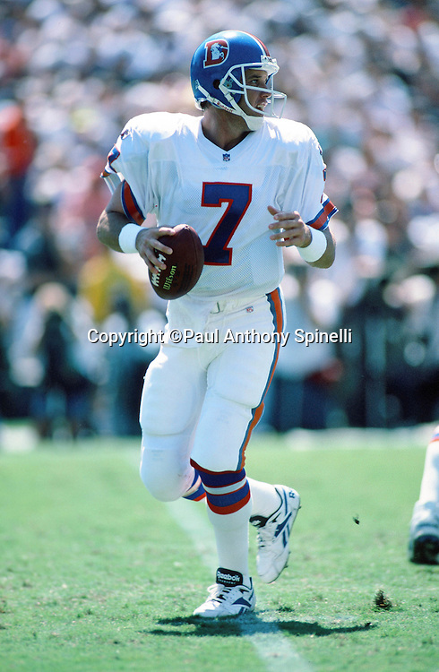 Denver Broncos quarterback John Elway (7) drops back to pass during the NFL football game against the San Diego Chargers on Sept. 24, 1995 in San Diego. The Chargers won the game 17-6. (©Paul Anthony Spinelli)