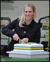 Zara Phillips cuts a John Deere cake at the Chelsea Flower Show, to help celebrate 50 years of producing the John Deere lawnmower. Monday, 20th May 2013.Picture by Andrew Parsons / i-Images<br />