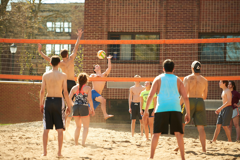 Activity; Playing; Socializing; Smiling; Buildings; Dorm; Location; Outside; People; Student Students; Spring; April; Time/Weather; sunny; Type of Photography; Candid; UWL UW-L UW-La Crosse University of Wisconsin-La Crosse; volleyball; Drake Field