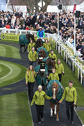 © Licensed to London News Pictures. 09/04/2016. Liverpool, UK. Former Grand National winning horses are walked around the parade ring on Grand National day of the Grand National 2016 at Aintree Racecourse near Liverpool. The race, which was first run in 1839, is the most valuable jump race in Europe. Photo credit : Ian Hinchliffe/LNP