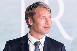 © Licensed to London News Pictures. 13/12/2016. MADS MIKKELESON attends the launch of Rogue One: A Star Wars Story. The film follows a group of unlikely heroes banding together on a mission to steal the plans to the Death Star, the Empire's ultimate weapon of destruction. This key event in the Star Wars timeline brings together ordinary people who choose to do extraordinary things, and in doing so, become part of something greater than themselves. London, UK. Photo credit: Ray Tang/LNP