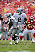 KANSAS CITY, MO - SEPTEMBER 20:   Darren McFadden #20 fakes the hand off from JaMarcus Russell #2 of the Oakland Raiders during a game against the Kansas City Chiefs at Arrowhead Stadium on September 20, 2009 in Kansas City, Missouri.  The Raiders defeated the Chiefs 13-10.  (Photo by Wesley Hitt/Getty Images) *** Local Caption *** Darren McFadden; JaMarcus Russell