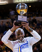 INDIANAPOLIS, IN - MARCH 08: Former Indiana Pacers player Darnell Hillman is presented with a trophy for winning the first NBA Slam Dunk contest in 1977 before the game against the Detroit Pistons at Bankers Life Fieldhouse on March 8, 2017 in Indianapolis, Indiana. NOTE TO USER: User expressly acknowledges and agrees that, by downloading and/or using this photograph, user is consenting to the terms and conditions of the Getty Images License Agreement. Mandatory Copyright Notice: Copyright 2017 NBAE (Photo by Michael Hickey/Getty Images) *** Local Caption *** Darnell Hillman