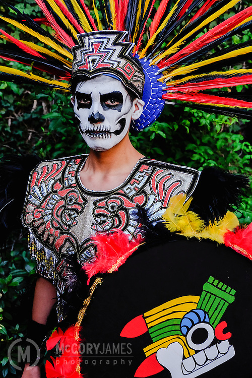 A young man dressed as an Aztec warrior for Dia de los Muertos