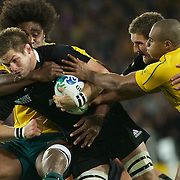 New Zealand Captain Richie McCaw is tackled by Radike Samo, Australia, during the New Zealand V Australia Semi Final match at the IRB Rugby World Cup tournament, Eden Park, Auckland, New Zealand, 16th October 2011. Photo Tim Clayton...